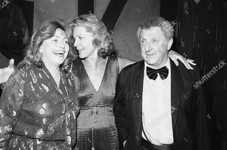 Gloria Jones, (left) widow of author James Jones, laughs with Lauren Bacall and Irwin Shaw at a party honoring the late writer in New York