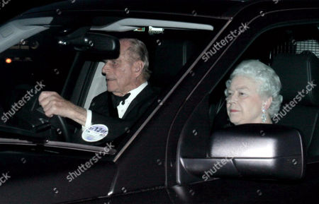 Prince Philip at the wheel of his Range Rover as he drives the Queen to the party thrown by Prince Edward and wife Sophie to celebrate the Queen's 81st birthday, at their home in Bagshot Park.