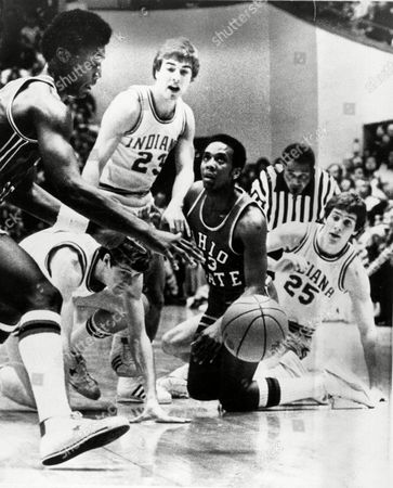 Terru Burris, Fred Poole, Scott Eells, Jimmy Wisman Ohio State players Fred Poole (31) and Terry Burris (43) and Indiana University players Scott Eells (31) Jim Wisman (23) and Bob Bender (25) tangle for a loose ball during early game action in Bloomington, Ind., . The top-ranked Indiana Hoosiers toppled OSU, 96-67 in their season finale, ending their second undefeated season