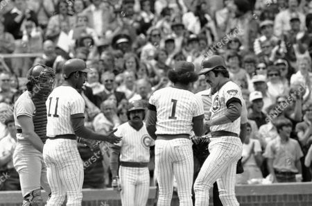 Bill Buckner, Jose Cardenal Chicago Cubs' Ivan DeJesus (11) and Jose Cardenal (1) greet teammate Bill Buckner, right, who arrives at the plate after smacking a first inning home run to score the three of them in game with Los Angeles Dodgers in Chicago, . At left is Dodgers catcher Steve Yeager