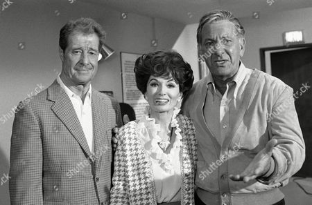 Don Ameche, left, and Ann Blyth, center, as guest stars, join Jack Klugman on the set for an episode of the television series, Quincy, Los Angeles, Calif. Klugman plays the title role, a medical examiner, in Quincy, after five years in The Odd Couple. Klugman was anxious for the series not to turn into just another detective show. What I like about Quincy is that you dont see forensic medicine anywhere else on television, he says. Youre not just another cop