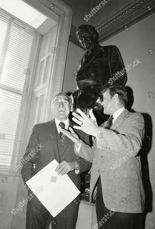 Sen. Dewey Bartlett, R-Okla., right, and actor James Whitmore chat beneath a statue of Will Rogers on Capital Hill, Washington, D.C. Whitmore is being honored by the Oklahoma State Society with the Will Rogers Centennial Commission for his significant contributions in perpetuating the wit and wisdom of cowboy philosopher Will Rogers