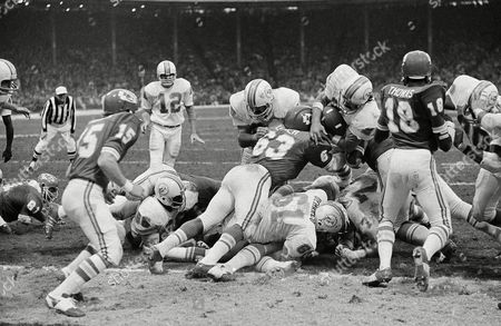 Miami's Jim Kiick (21) gets to the less-then-a-foot line before being stopped by Kansas City's Willie Lanier (63) in the playoff game with the Chiefs. On the next play, Kiick scored for the Dolphins. Miami beat Kansas City 27-24 in an overtime period on in Kansas City