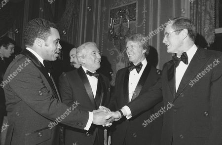 Former Georgia Gov. Jimmy Carter second from right, shakes hands with prominent New Jersey officials at the New Jersey Democrats' Jefferson- Jackson Day dinner, where he was a speaker, at New York's Waldorf Astoria Hotel. Peter Rodino, second from left, chairman of the House Judiciary Committee was honored and the recipient of an award. Newark, N.J. Mayor Kenneth Gibson at left, with New Jersey Gov. Byn Brendan at right