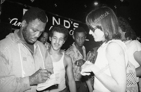 Joe Frazier Heavyweight contender Joe Frazier takes time out from a pre-dawn workout to sign autographs for fans in Times Square, New York . Collecting his signature is visitor Janis Stephenson of Vancouver, British Columbia. Frazier is scheduled to meet world champion Muhammad Ali in Manila, September 30