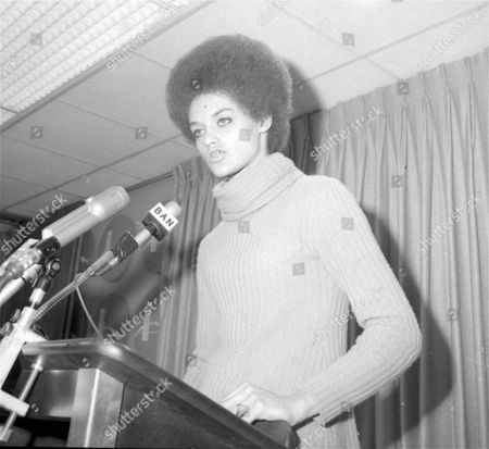 Kathleen Cleaver, wife of Black Panther leader Eldridge Cleaver, speaks at a news conference at New York's Kennedy Airport, after she arrived back in the U.S. after two and a half years absence. Eldridge Cleaver said October 15, that he would return from self imposed exile in Algiers to the U.S. soon to resume revolutionary activities