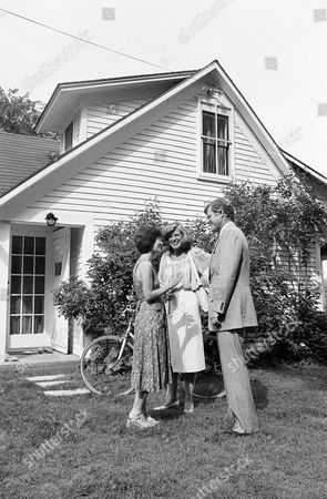 Poetess Katha Pollitt, left, talks Sen. Edward M. Kennedy and his sister, Eunice Shriver after being chosen to live in the house once occupied by Robert Frost, Franconia, NH. Kennedy dedicated The Frost Place on Thursday