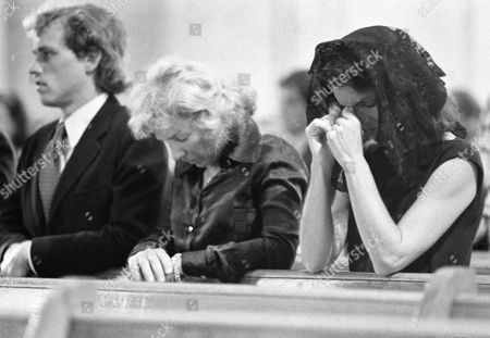 Ethel Kennedy, center, Jacqueline Kennedy Onassis, right, and Joseph Patrick Kennedy II, mourn a family friend, Kenneth O'Donnell, during service at Blessed Sacrament Church, Jamaica Plain, Boston, Mass