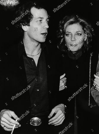 Actress Lauren Bacall holds the arm of her son, Stephen Bogart during a reception at the Palace Theater in New York City, . A reception by Knopf book company, marked the publication of Miss Bacall's autobiography, which, among other items, gives details of Miss Bacall's marriage to the late actor Humphrey Bogart, Stephen's father