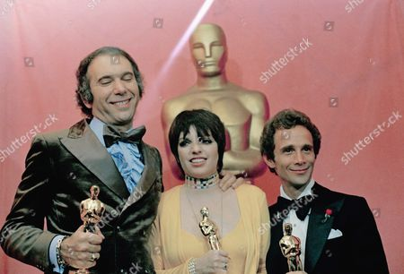 "Liza Minnelli holds her Oscar for ""Actress in a Leading Role,"" poses wtih Joel Grey,at right, who won for ""Actor in a Supporting Role,"" both appearing in film, ""Cabaret, at the 45th Academy Awards show on . At left is Albert S. Ruddy, producer for ""The Godfather"" winning an Oscar for ""Best Picture"