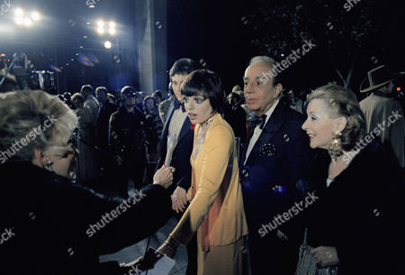 Liza Minnelli is greeted by ABC's entertainment reporter Rona Barrett, left, as she arrives with her boyfriend Desi Arnaz, Jr. and her father Vincent Minnelli at the Academy Awards ceremony. At right is Denise Minnelli, wife of the director. This is the 45th Academy Awards show on at Los Angeles, Calif