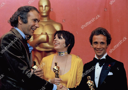 "Stock Image of Liza Minnelli, holds her Oscar for ""Actress in a Leading Role,"" poses with Joel Grey,at right, who won for ""Actor in a Supporting Role,"" both appearing in film, ""Cabaret,"" at the 45th Academy Awards show on . At left is Albert S. Ruddy, producer for ""The Godfather"" winning an Oscar for ""Best Picture"