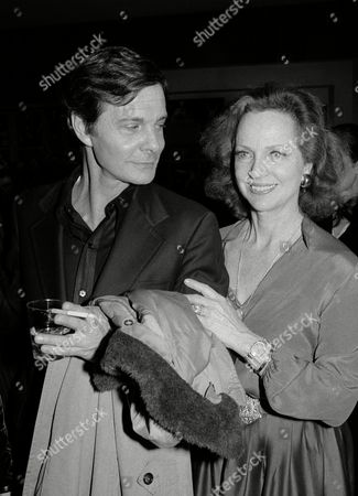 """Actors Louis Jourdan and Beatrice Straight have a drink in the lobby of the Circle in the Square Theatre in New York, . They were at a party in the lobby of the theater after the premiere of """"13 Rue de L'Amour,"""" in which Jourdan stars"""