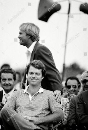 Watson Nicklaus Masters champion Tom Watson, seated, waits for ceremonies at the Augusta National Golf Club as runner-up Jack Nicklaus pats him on the shoulder in Augusta, Ga., . Watson won with a score of 280 and Nicklaus tied with Johnny Miller with 282