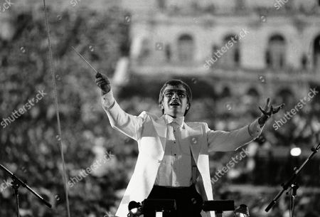 Conductor Maxim Shostakovich, who defected from the Soviet Union, conducts the traditional free Memorial Day concert on the West Lawn of the Capitol in Washington. Shostakovich, in his first performance since he defected, opened with America's national Anthem