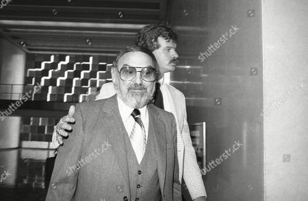 Stock Image of Melvin Weinberg foreground, leaves federal court in Brooklyn, New York City on