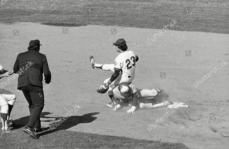 New York Mets second baseman Doug Flynn ends up on top of the Montreal Expos' Dave Cash during the 3rd inning at Shea Stadium in New York. Andre Dawson was safe at first on the play as the New York Mets won the home opener, 3-1 over the Expos