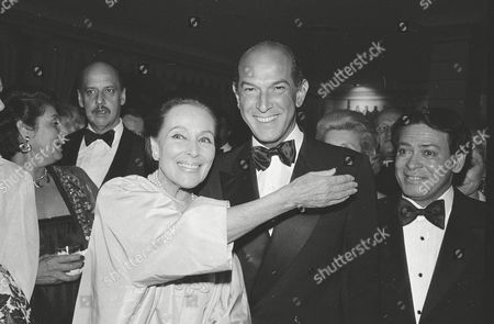 """Stock Image of Oscar de la Renta del Rio, Dolores del Rio Actress Dolores del Rio, left, stands with fashion designer Oscar de la Renta at the Casita Maria Benefit dinner at the Pierre Hotel in New York where the two were honored. The Museum of Modern Art in New York will present a sampling of Mexico's film noir in late July 2015. Among the films presented is """"La otra"""" (1946), with actress Dolores del Rio"""