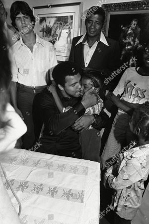Alisha Walker, 7, from New York City is kissed by world heavyweight boxing champion Muhammad Ali at Madison Square Garden?s Hall of Fame in New York on . Ali was at the Hall of Fame to participate in a press conference with Ernie Shavers in connection with their title bout to the fought September 29 at Madison Square Garden
