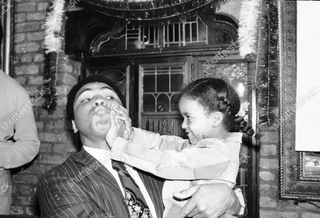 Muhammad Ali?s newest fan, little Donna Smith, 5, resists a big kiss from the champ at a New York restaurant on . There, Ali and Belgium?s Jean-Pierre Coopman announced that they would meet in a heavyweight Bout on February 20