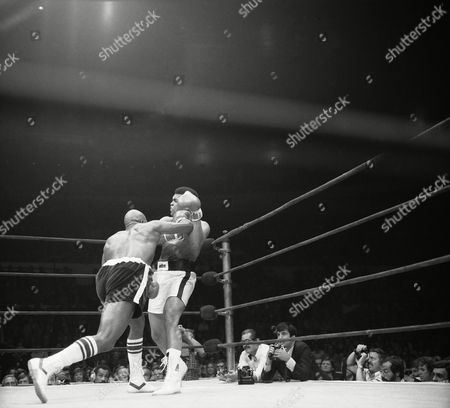 Earnie Shavers lands a hard right hook to the left jaw of world heavyweight champ Muhammad Ali during the seventh round of their 15-round bout in New York?s Madison Square Garden on . Shavers kept Ali busy with a flurry of rights throughout the title match