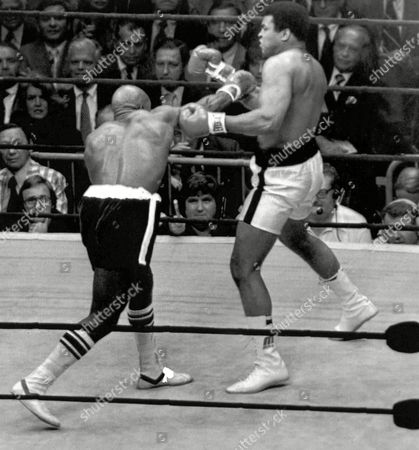 Image shows American boxer Muhammad Ali, right, and his opponent, American boxer Earnie Shavers, during their Heavyweight Title fight at Madison Square Garden