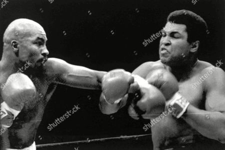 Image shows American boxer Muhammad Ali, right, and his opponent, American boxer Earnie Shavers, during the 1st round of their Heavyweight Title fight at Madison Square Garden