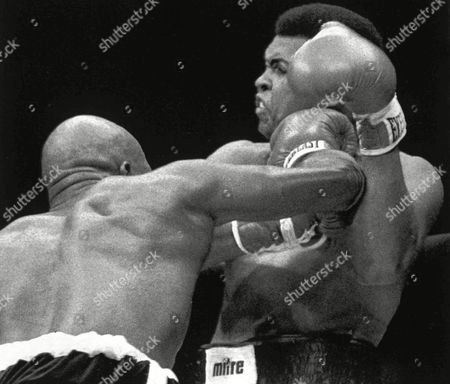 Image shows American boxer Muhammad Ali, right, and his opponent, American boxer Earnie Shavers, during the 7th round of their Heavyweight Title fight at Madison Square Garden