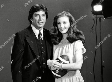 Namath Holden New York Jets quarterback Joe Namath poses with model Rebecca Holden in a New York film studio, . Namath spent a day before the cameras to do commercials for a line of clothing bearing his name