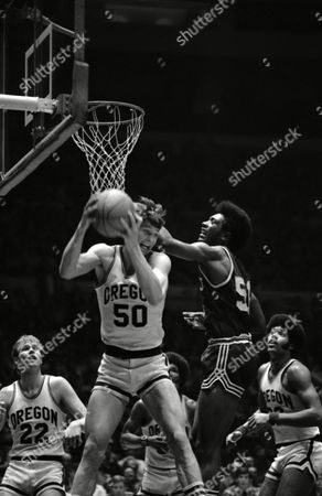 Oregon's Gerald Willett (50) beats Oral Roberts' Harold Johnson (51) to rebound in second half of National Invitation Tournament game at New York's Madison Square Garden, . Oregon's Ken Robinson (22) is at left. Oregon defeated Oral Roberts 68-59 in the NIT quarter-final game