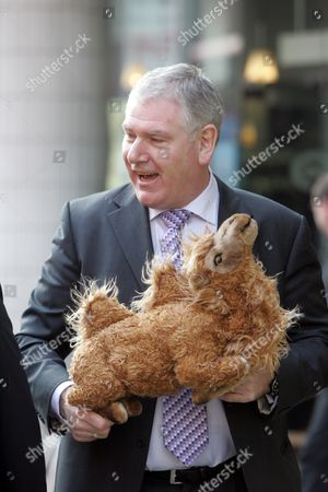 Editorial picture of Paul Moloney of the GMB Union arrives at a meeting with private equity firm Primera to give Damon Buffini, Primera CEO a toy camel, London, Britain - 27 Mar 2007
