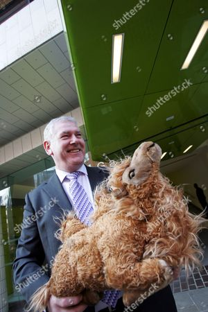 Paul Moloney of the GMB Union arrives at a meeting with private equity firm Primera to give Damon Buffini, Primera CEO, a toy camel