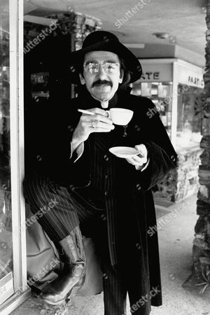 "Novella Actor Don Novello poses as Father Guido Sarducci, a character he portrays on ""Saturday Night Live,"" as he smokes a cigarette and drinks a cup of coffee in Los Angeles, Calif., in 1980. His character is a self-styled Vatican columnist on the weekly television variety show"