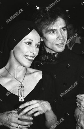 "Rudolf Nureyev and Patricia Ruanne chat with guests at a party in New York, following the opening appearance of the London Festival Ballet. The company's opening night performance was ""Romeo and Juliet"" in a version choreographed by Nureyev"