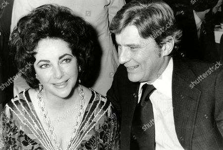 Taylor Warner Actress Elizabeth Taylor and her husband, former secretary of the U.S. Navy John Warner, at the 42nd New York Film Critics Circle Awards dinner in New York. Publicist Sally Morrison says Taylor died in Los Angeles of congestive heart failure at age 79