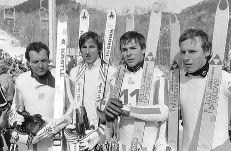 Stock Photo of Werner Grissmann, Leonhard Stock, Peter Wirnsberger,Harti Weirather Austrian downhillers, who will compete in the Olympic downhill event on Thursday, at White face mountain, pose in the finish of the race course on in Lake Placid, New York, after the last training run. L/r Werner Grissmann, Leonhard Stock, Peter Wirnsberger and Harti Weirather. Acting world champion Sepp Walcher is eliminated