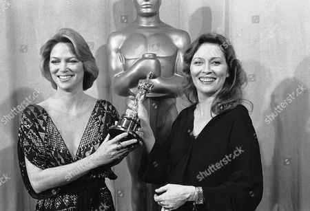 Actress Faye Dunaway, right, wins the best actress award at the Academy Awards show in Los Angeles, . With her is presenter of the Oscar, actress Louise Fletcher, a previous winner