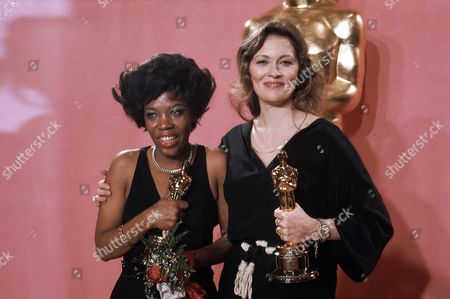 "Faye Dunaway, right, holds the Oscar she won for best actress in ""Network,"" . Woman at left is Eletha Finch, holding Oscar she accepted for her late husband, Peter Finch, who was named best actor for his performance in ""Network"" in Los Angeles. Finch died on January 14"