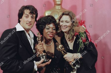 "Faye Dunaway, right, holds the Oscar she won for best actress in ""Network,"" . Woman at center is Eletha Finch, holding Oscar she accepted for her late husband, Peter Finch, who was named best actor for his performance in ""Network"" in Los Angeles. Finch died on January 14. At right is Sylvester Stallone, holding his Oscar for his performance in ""Rocky"