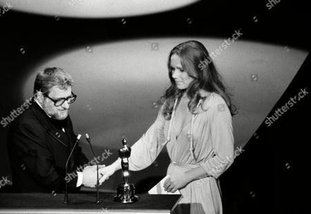 "Paddy Chayefsky accepts the Best Actor award for the late Peter Finch from actress Liv Ullmann, at the Academy Awards in Los Angeles, . Finch was the star of the film, ""Network."" Chayefsky wrote the screenplay for the film"