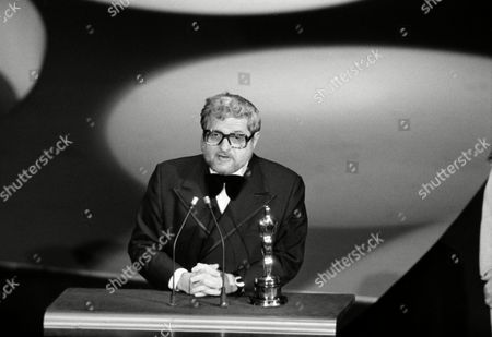 "Paddy Chayefsky accepts the Best Actor award for the late Peter Finch, at the Academy Awards in Los Angeles, . Finch was the star of the film, ""Network."" Chayefsky wrote the screenplay for the film"
