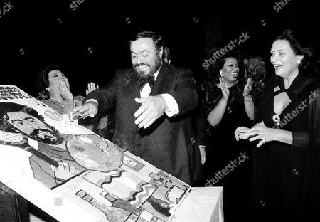 Pavarotti Italian tenor Luciano Pavarotti blows out the candles on his cake in honor of his 45th birthday at a surprise party after the 5th Annual Richard Tucker Memorial concert at City Center in New York City, . Laughing at left is mezzo soprano Marilyn Horne. The others are not identified