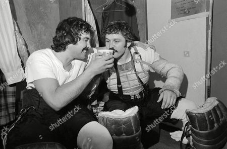 Bobby Taylor, Bernie Parent Philadelphia Flyers goalies Bobby Taylor, left, and Bernie Parent share from a cup of victory drink in the dressing room after the Flyers beat the Rangers in the semi-final round final of the NHL playoffs in Philadelphia on