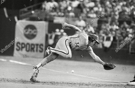 Phillies first baseman Pete Rose (14) lunges and misses a hot grounder off the bat of Astros shortstop Craig Reynolds during second inning action, Houston, Tex. The ball went to the outfield for a double