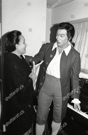 """Actress Dolores Del Rio visits tenor Domingo Placido backstage before his performance of """"Manon Lescaut"""" at the Metropolitan Opera House in New York, . The opera is to be broadcast live from the Met to Germany, Austria, Hungary, Czechoslovakia and Romania. It is the first live broadcast overseas from America's leading opera house"""