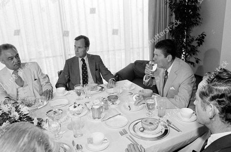 Ronald Reagan, George Bush Ronald Reagan and George Bush attend a breakfast meeting with Detroit Mayor Coleman Young, Gov. Milliken, and some of Reagan's advisors in Detroit on