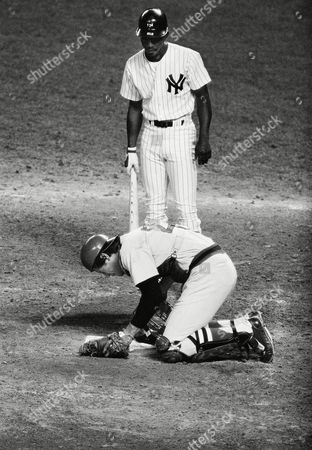 Boston Red Sox catcher Carlton Fisk doubles over after the New York Yankee Mickey Rivers, behind him tipped a foul into Fisk in the second inning at Yankee Stadium in New York