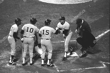 New York Yankees' Reggie Jackson crosses home plate after a two RBI home run in the second inning against the Boston Red Sox at Fenway Park. Lined up at home is Mickey Rivers (17), Chris Chamblis (10), and Thurman Munson (15