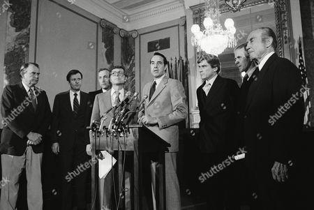 Eight members of the Senate face reporters to give their views on the Salt II Treaty, Washington, D.C. From left are: Sen. Henry Bellmon; R-Okla., Sen. William Armstrong; R-Col., Sen. Richard Schweiker; R-Pa., Sen. Pete Domenici; R-N.M,. Sen. Robert Dole; R-Kan, Sen. John Warner; R-Va., Sen. Gordon Humphrey; R-N.H., and Sen. Strom Thurmond; R-S.C