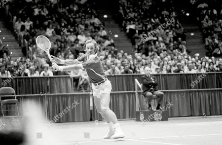 Rod Laver Australia's Rod Laver, tongue between his teeth and eyes on the ball, prepares to return a backhand shot to Arthur Ashe of the United States in their singles match in the World Cup Tennis Tournament in Hartford on . Laver beat Ashe 6-2; 7-6 to clinch the cup for Australia for the fourth straight year